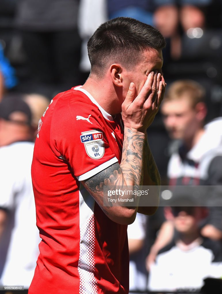 Adam Hammill of Barnsley reacts as Barnsley are relegated during the Sky Bet Championship match between Derby County and Barnsley at iPro Stadium on May 6, 2018 in Derby, England.