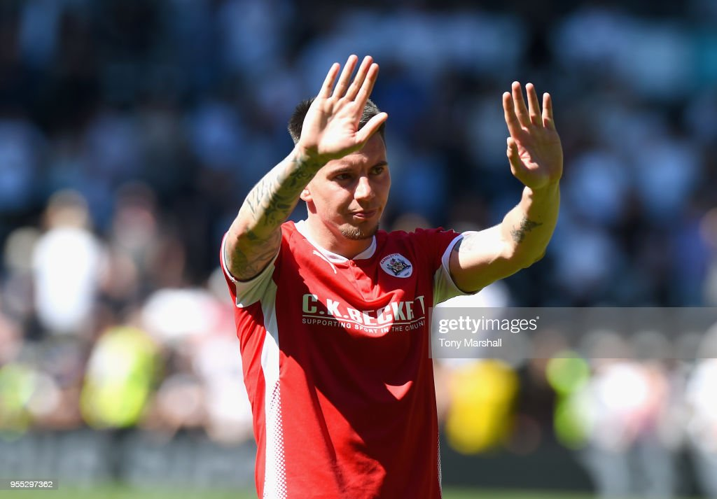 Adam Hammill of Barnsley shows his appreciation of the fans as Barnsley are relegated during the Sky Bet Championship match between Derby County and Barnsley at iPro Stadium on May 6, 2018 in Derby, England.