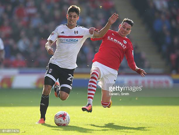 Adam Hammill of Barnsley under pressure from Lucas Piazon of Fulham during the Sky Bet Championship match between Barnsley and Fulham at Oakwell...