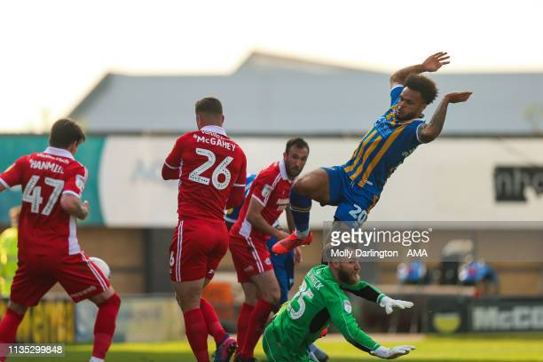 Adam Hammill of Scunthorpe United scores an own goal to make it 11 following a Shaun Whalley of Shrewsbury Town cross during the Sky Bet League One...