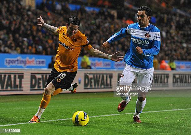 Adam Hammill of Wolves in action with Keiran Richardson of Sunderland during the Barclays Premier League match between Wolverhampton Wanderers and...