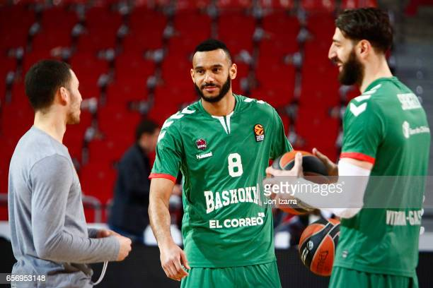 Adam Hanga #8 of Baskonia Vitoria Gasteiz talking with Mike James #5 of Panathinaikos Superfoods Athens and Tornike Shengelia #23 of Baskonia Vitoria...