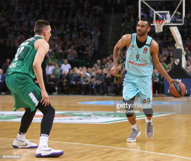 Adam Hanga #9 of FC Barcelona Lassa competes with Edgaras Ulanovas #92 of Zalgiris Kaunas in action during the 2017/2018 Turkish Airlines EuroLeague...