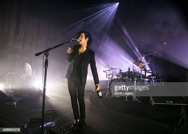 Adam Hann Matthew Healy and George Daniel of The 1975 performs at The Fillmore Detroit on November 4 2014 in Detroit Michigan