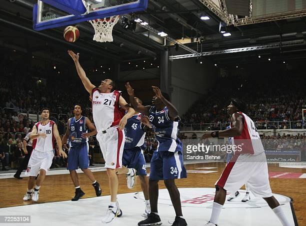Adam Harrington of Bamber drives to the basket against Kevin Johnson of Frankfurt during the Basketball Bundesliga match between Brose Baskets and...