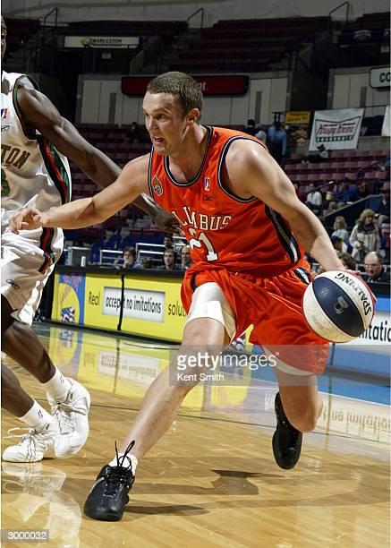 Adam Harrington of Columbus RiverDragons drives to the basket against the Charleston Lowgators at the North Charleston Civic Center February 20, 2004...