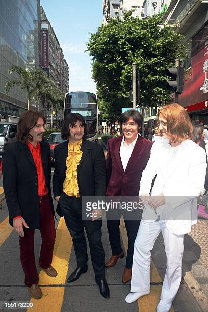 Adam Hastings Andre Barreau Hugo Degenhardt and Steve White of The Bootleg Beatles pose for photos at Nathan Road before their Hong Kong concert on...