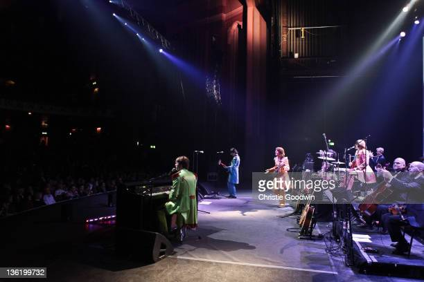 Adam Hastings David CatlinBirch Andre Barreau and Hugo Degenhardt of The Bootleg Beatles perform on stage at the Hammersmith Apollo on December 19...