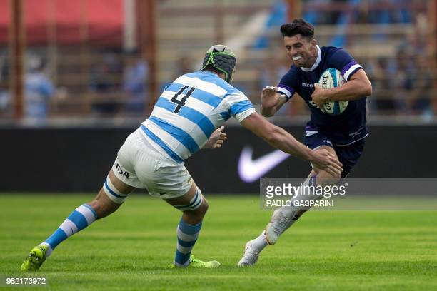 Adam Hastings from Scotland runs with the ball during their international test match against Argentina at the Centenario stadium in Resistencia Chaco...