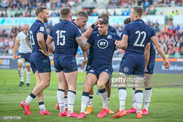 Adam Hastings of Scotland is congratulated by his teammates after scoring a try during the 2020 Guinness Six Nations match between Italy and Scotland...