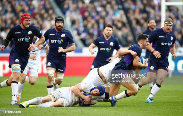 Adam Hastings of Scotland is tackled by Wenceslas Lauret of France during the Guinness Six Nations match between France and Scotland at Stade de...