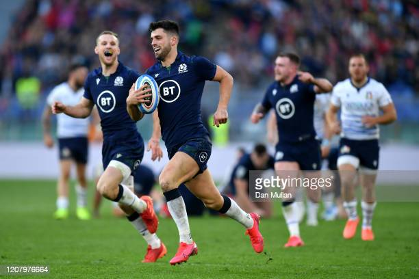 Adam Hastings of Scotland makes a break to score his sides third try during the 2020 Guinness Six Nations match between Italy and Scotland at Stadio...