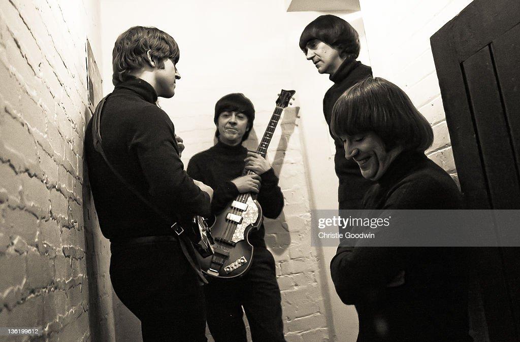 Adam Hastings,David Catlin-Birch,Andrea Barreau and Hugo Degenhardt of The Bootleg Beatles backstage at the Hammersmith Apollo on December 19, 2011 in London, UK.