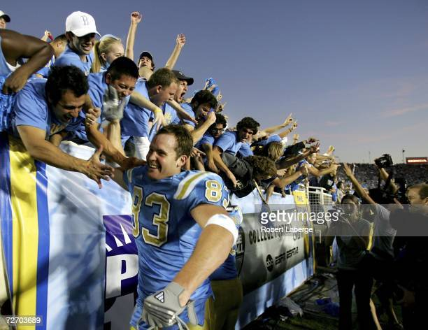 Adam Heater of the UCLA Bruins celebrates with fans after defeating the USC Trojans on December 2 2006 at the Rose Bowl in Pasadena California The...