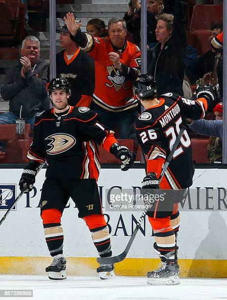 Adam Henrique and Brandon Montour of the Anaheim Ducks celebrate Henrique's goal in the second period during the game against the Ottawa Senators on...
