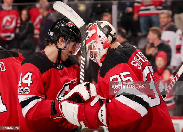 Adam Henrique and Cory Schneider of the New Jersey Devils celebrate the 21 win over the Florida Panthers on November 11 2017 at Prudential Center in...