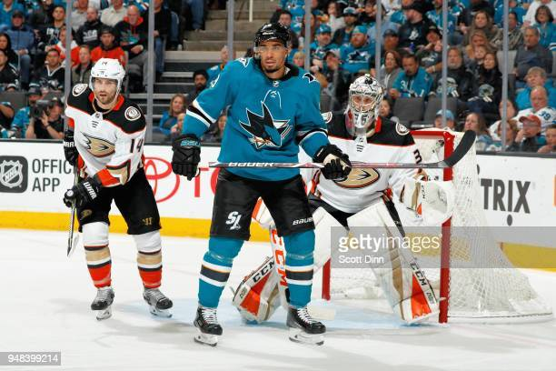 Adam Henrique and John Gibson of the Anaheim Ducks defend Evander Kane of the San Jose Sharks in Game Four of the Western Conference First Round...
