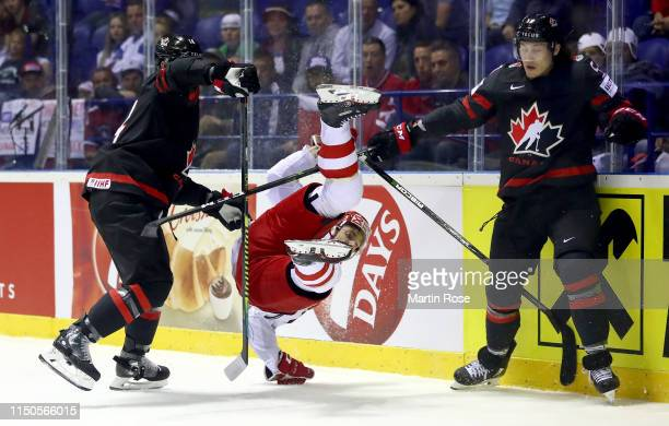 Adam Henrique and Tyler Bertuzzi of Canada challenge Jesper Jensen Aabo of Denmark during the 2019 IIHF Ice Hockey World Championship Slovakia group...