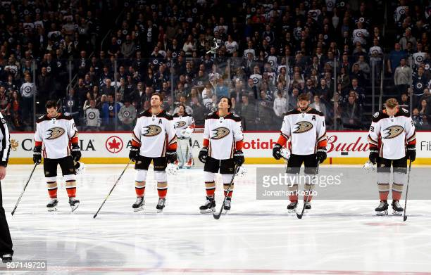 Adam Henrique Cam Fowler Brandon Montour Ryan Kesler and Jakob Silfverberg of the Anaheim Ducks stand on the ice during the singing of the National...