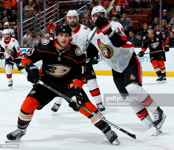 Adam Henrique of the Anaheim Ducks battles for position against Alex Burrows of the Ottawa Senators during the game on December 6 2017 at Honda...