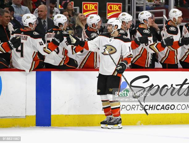 Adam Henrique of the Anaheim Ducks is congratulated by teammates after scoring the winning goal in the third period against the Chicago Blackhawks at...