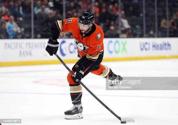 Adam Henrique of the Anaheim Ducks skates the puck against the Minnesota Wild in the first period at Honda Center on October 15, 2021 in Anaheim,...