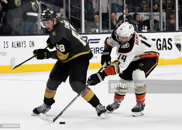 Adam Henrique of the Anaheim Ducks steals the puck from Nate Schmidt of the Vegas Golden Knights in overtime of their game at TMobile Arena on...