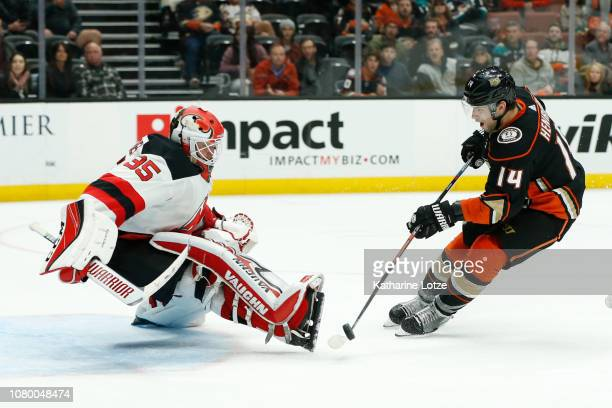 Adam Henrique of the Anaheim Ducks takes a shot on goal as Cory Schneider of the New Jersey Devils blocks at Honda Center on December 09 2018 in...