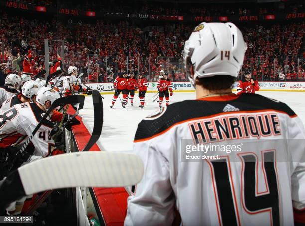 Adam Henrique of the Anaheim Ducks watches the New Jersey Devils celebrtae a third period goal by Jesper Bratt of the New Jersey Devils at the...
