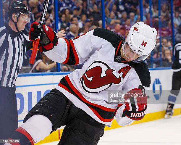 Adam Henrique of the New Jersey Devils celebrates his goal against the Tampa Bay Lightning during the second period at the Amalie Arena on April 2...