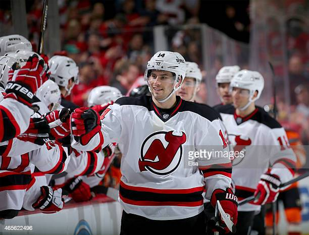 Adam Henrique of the New Jersey Devils celebrates his goal with teammates on the bench in the third period against the Philadelphia Flyers on March 8...