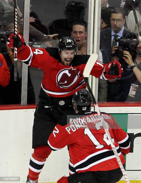 Adam Henrique of the New Jersey Devils celebrates with teammate Alexei  Ponikarovsky after scoring in overtime 0ad635bb5