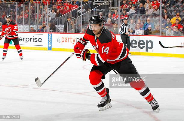 Adam Henrique of the New Jersey Devils in action against the Buffalo Sabres at the Prudential Center on November 12 2016 in Newark New Jersey The...