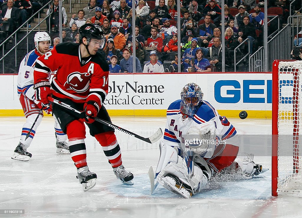 3c6a6a50d Adam Henrique of the New Jersey Devils is stopped by Henrik ...