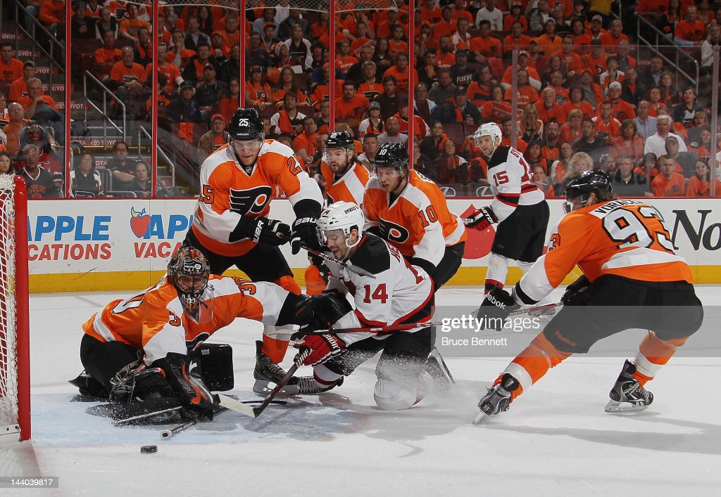 Adam Henrique #14 of the New Jersey Devils is stopped by Ilya Bryzgalov #30 and the Philadelphia Flyers in the first period in Game Five of the Eastern Conference Semifinals during the 2012 NHL Stanley Cup Playoffs at Wells Fargo Center on May 8, 2012 in Philadelphia, Pennsylvania.