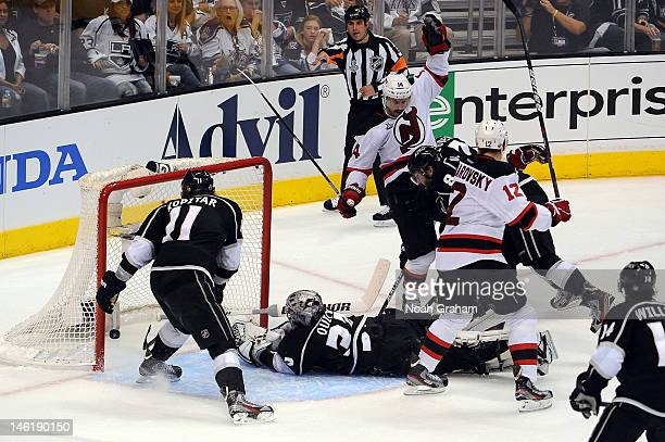 Adam Henrique of the New Jersey Devils reacts after scoring a goal against Jonathan Quick of the Los Angeles Kings in Game Six of the 2012 Stanley...