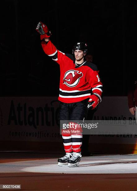 Adam Henrique of the New Jersey Devils salutes the fans after being named the number one star of the game after defeating the Florida Panthers at the...