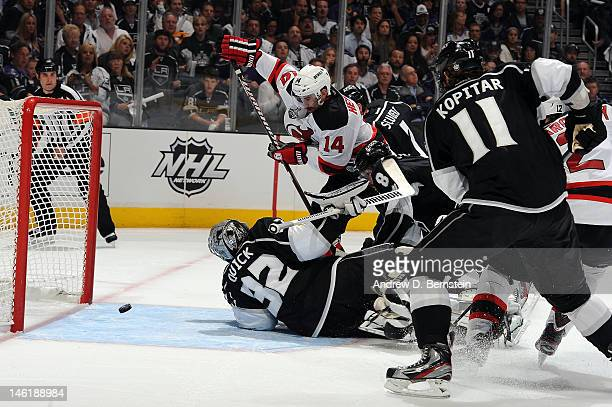 Adam Henrique of the New Jersey Devils scores a goal against Jonathan Quick of the Los Angeles Kings in Game Six of the 2012 Stanley Cup Final at...
