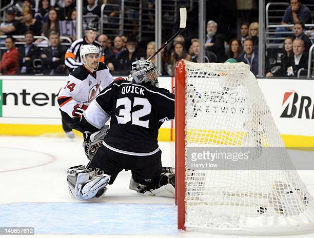 Adam Henrique of the New Jersey Devils scores a goal over goaltender Jonathan Quick of the Los Angeles Kings in the third period of Game Four of the...
