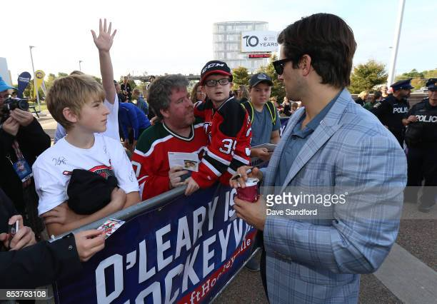 Adam Henrique of the New Jersey Devils signs autographs for fans during Kraft Hockeyville Canada on September 25 2017 at Credit Union Place in...