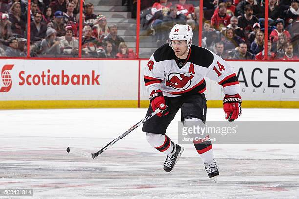 Adam Henrique of the New Jersey Devils skates against the Ottawa Senators at Canadian Tire Centre on December 30 2015 in Ottawa Ontario Canada