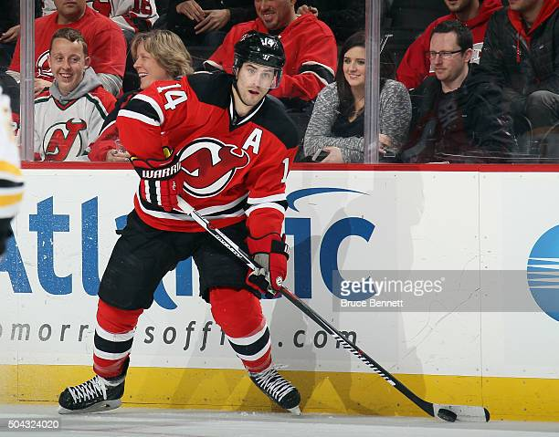 Adam Henrique of the New Jersey Devils skates in his first NHL game against the Boston Bruins at the Prudential Center on January 8 2016 in Newark...