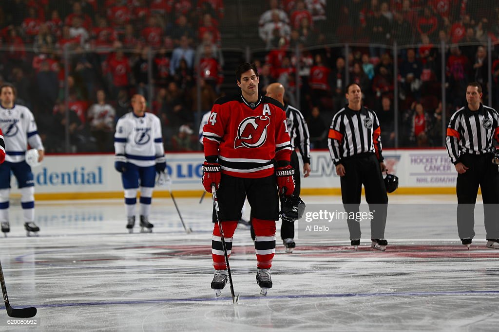 Adam Henrique #14 of the New Jersey Devils stands for the National Anthem against the Tampa Bay Lightning at the Prudential Center on October 29, 2016 in Newark, New Jersey.