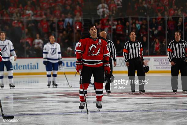 Adam Henrique of the New Jersey Devils stands for the National Anthem against the Tampa Bay Lightning at the Prudential Center on October 29 2016 in...