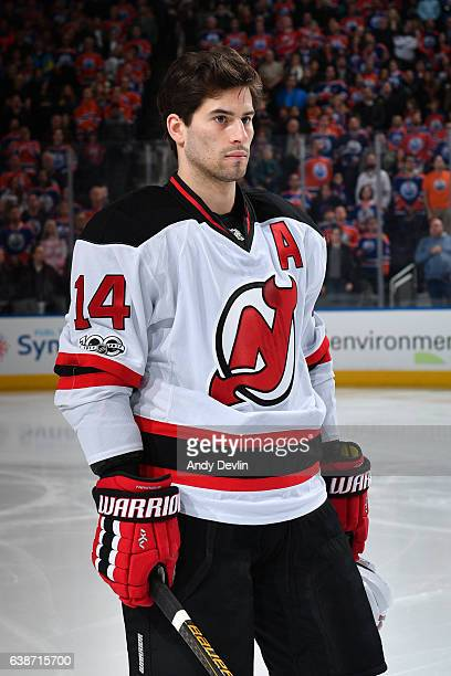 Adam Henrique of the New Jersey Devils stands for the singing of the national anthem prior to the game against the Edmonton Oilers on January 12 2017...