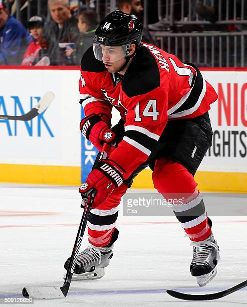 Adam Henrique of the New Jersey Devils takes the puck in the first period against the Washington Capitals on February 6 2016 at Prudential Center in...