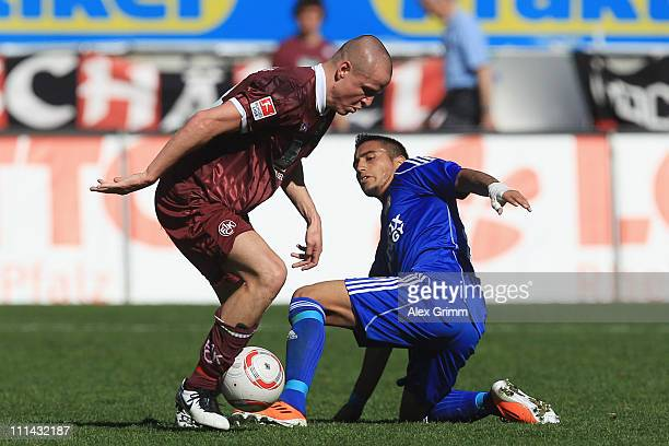 Adam Hlousek of Kaiserslautern is challenged by Arturo Vidal of Leverkusen during the Bundesliga match between 1. FC Kaiserslautern and Bayer...