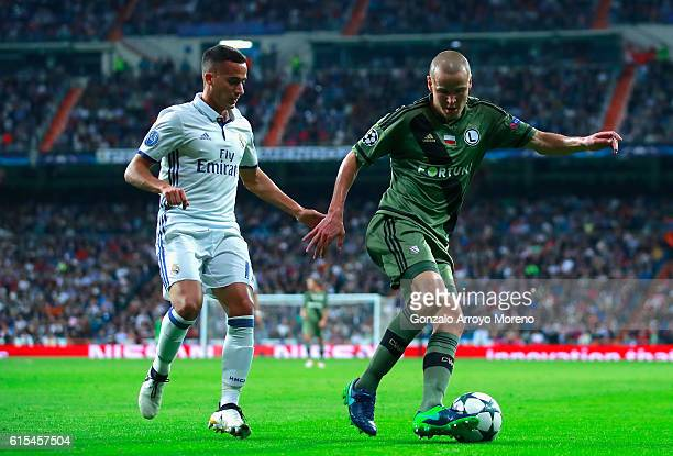 Adam Hlousek of Legia Warszawa and Lucas Vazquez of Real Madrid compete for the ball during the UEFA Champions League Group F match between Real...