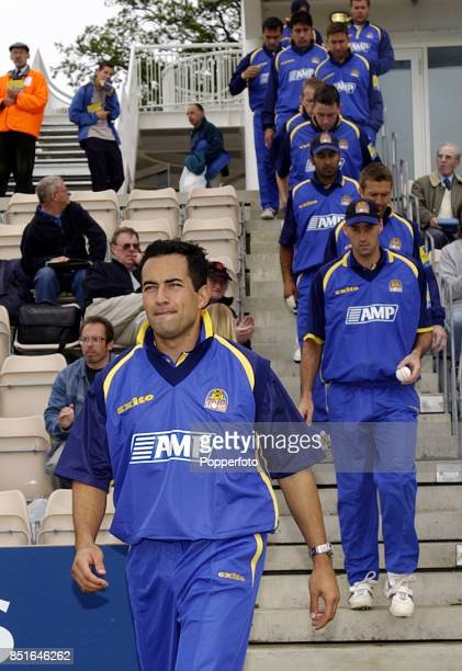Adam Hollioake captain of Surrey leads his team out for Norwich Union League match between Hampshire and Surrey at The Rose Bowl in Southampton...