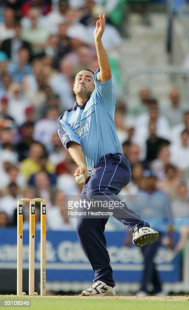 Adam Hollioake of England bowls during the Tsunami Twenty20 relief game for The Oval Cricket Relief Trust Asia XI against International XI at The...